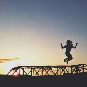 Girl Silhouette over Bridge